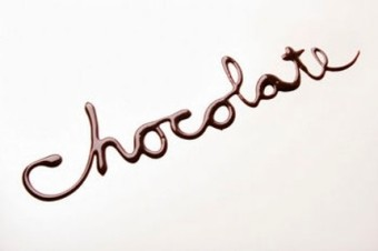 The word chocolate written in chocolate syrup on white backgroun