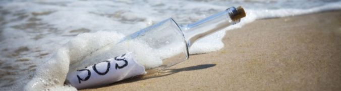 Sos-bottle-on-beach